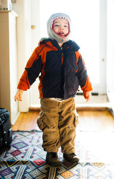 A young boy is dressed and ready for cold weather.