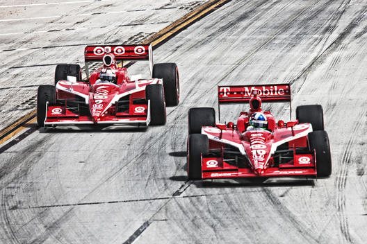 Two red racecars; Toyota Long Beach Grand Prix; Indycar racing; #9 & #10 cars