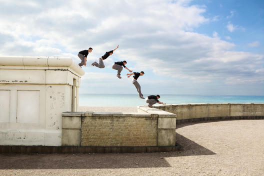 Parkour athlete experimenting with movement at Balcombe Viaduct, Sussex, United Kingdom