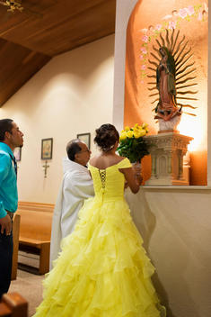 Hispanic girl celebrating quinceanera in Catholic church