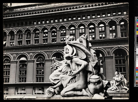 Classical style sculptures in front of an elaborate building exterior.