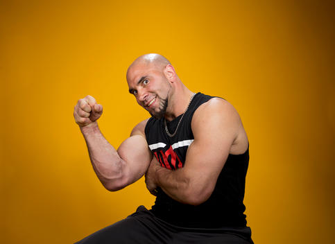 Arm wrestling competitor Mike Selearis flexes his muscles and shows off his arms