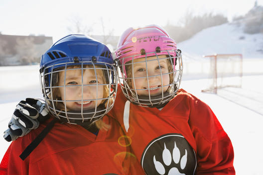 Portrait of smiling girls in ice hockey uniform