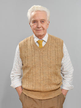 Smiling Senior Man With Hands In Pockets