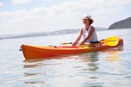 Senior woman sea kayaking