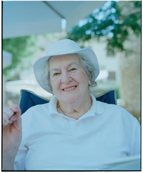 Portrait Of Senior Woman Of Caucasian Appearance Relaxing In Shade