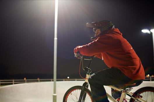 BMX-cyclist riding at night time