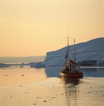 Fishing boat in icy waters, Disko Bay, Greenland