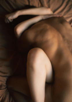 Nude couple making love, rear view, close-up, blurred