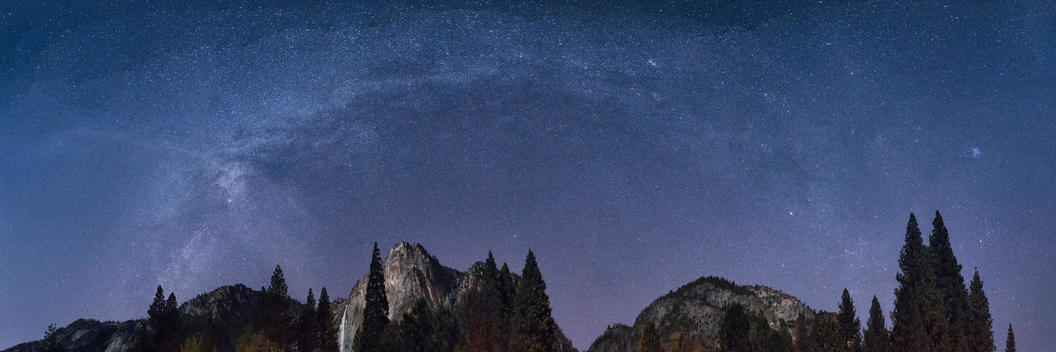 Mountains and treetops under starry night sky, Tuolumne, California, United States