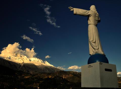 Statue Of Jesus Christ Facing Peru\'S Highest Mountain In The Cordillera Huayhuash Range