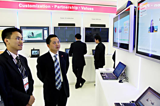 Businessmen Of Asian Appearance At A Technology Expo, Istanbul, Turkey.