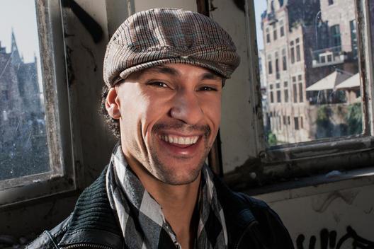Portrait Of Latino Man Smiling At Camera.