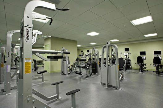 Windowless Gym With Workout Equipment