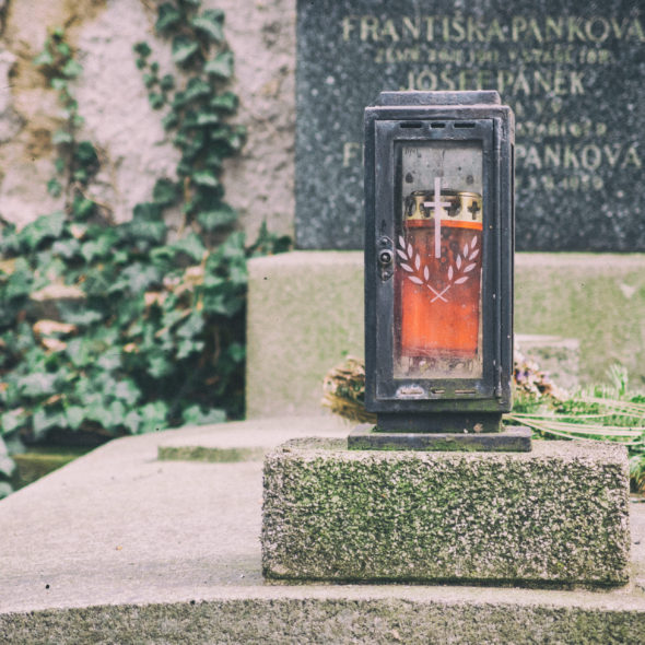Old grave with candle