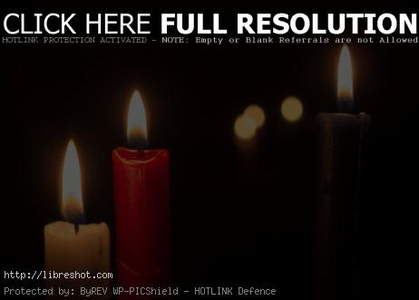 Three Candles On A Black Background