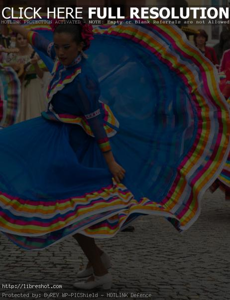 Free image of Dancing woman in traditional mexican dress