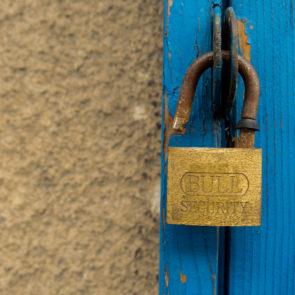 Old door and an open padlock