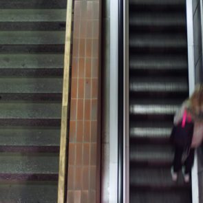 Woman On Moving Staircase
