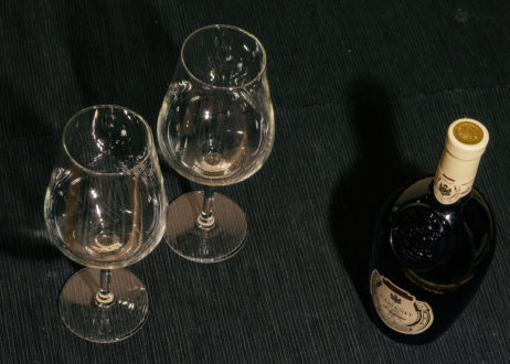 Two Glasses And Bottle Of Red Wine On Black Background