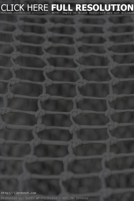 Free image of White net of soccer goal in detail