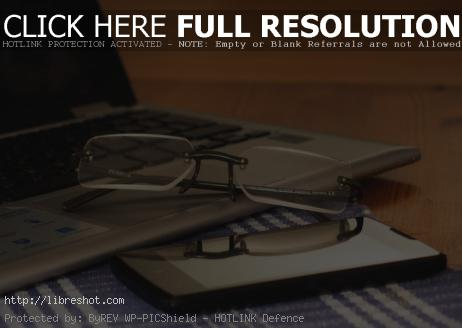 Glasses, Laptop And Phone On The Office Desk