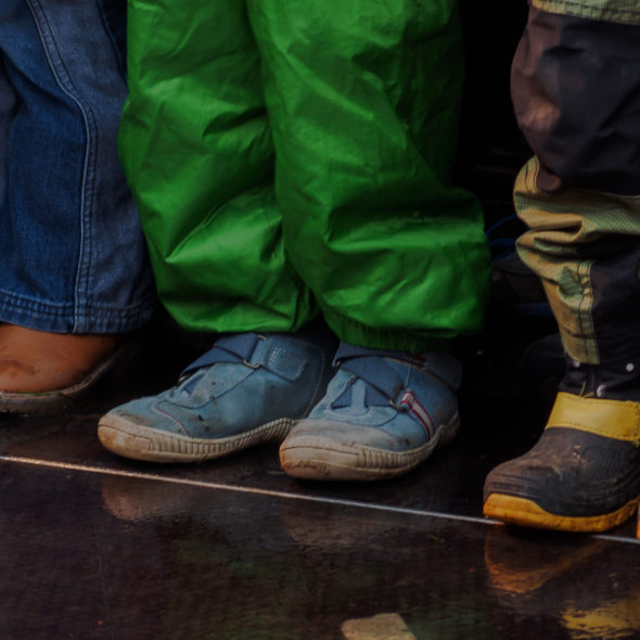 Three children standing – shoes and feet