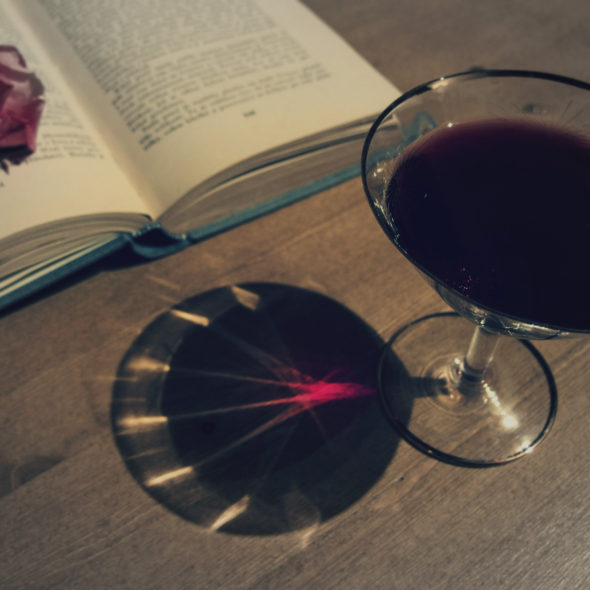 Wine, book and rose