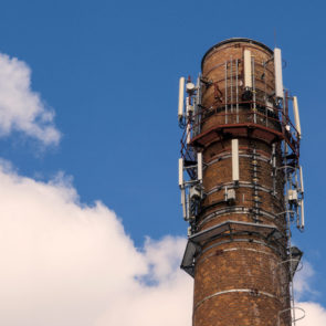 Old brick chimney with mobile phone antennas