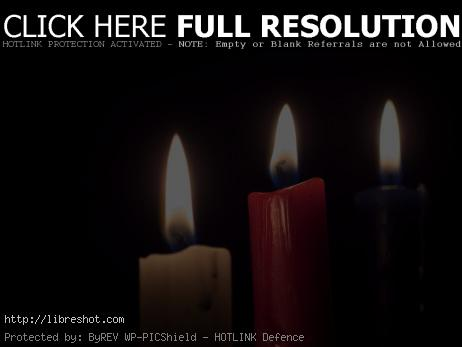 Free image of Three candles on a black background