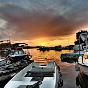 Sunset And Boats