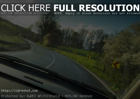 Free image of View from a fast-moving car in the curve