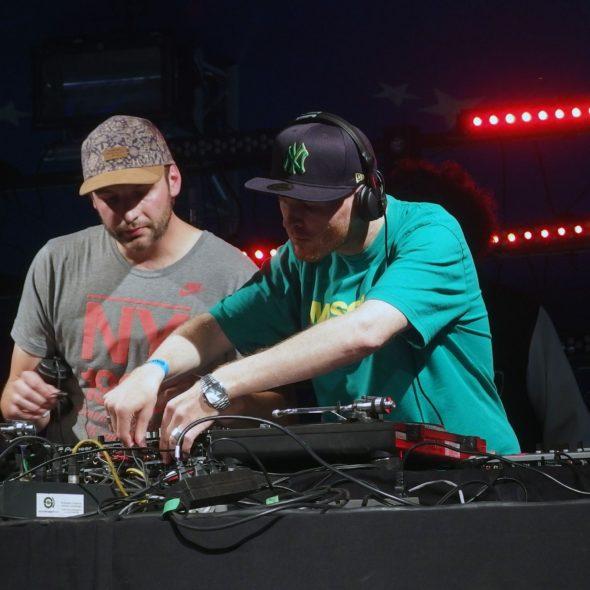 2 DJ behind the mixer