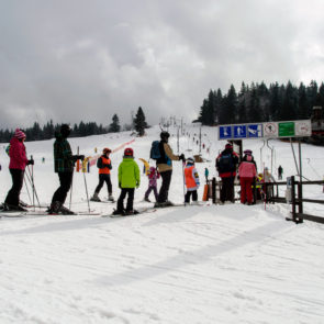Queue of skiers at ski lift