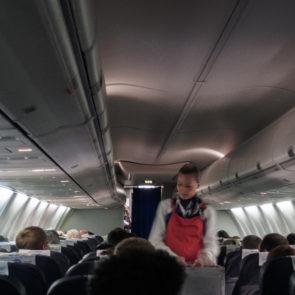 Flight attendant in aircraft