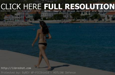 Free image of Woman Walking on the Beach