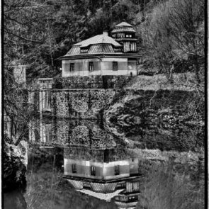 House reflected in water