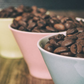 Three cups with coffee beans