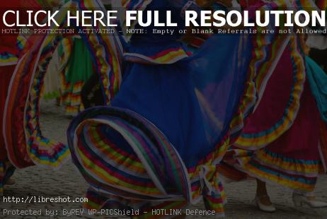 Free image of A dancers in a colorful dress