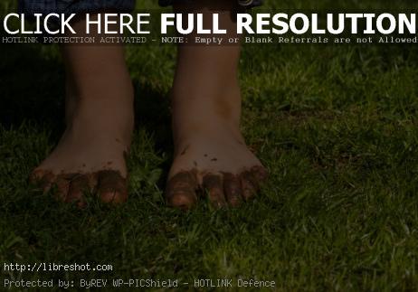Free image of Muddy children feet