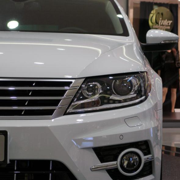 White Car On Autosalon Or Car sales