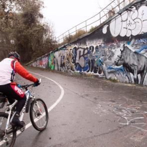 Cyclist With Graffiti Wall