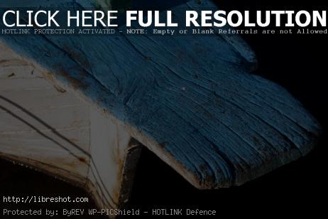 Free image of White and blue wooden boat with wood texture