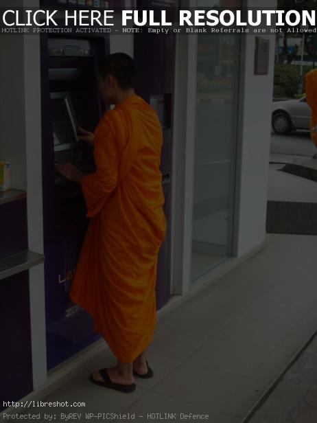 Buddhist monk and ATM