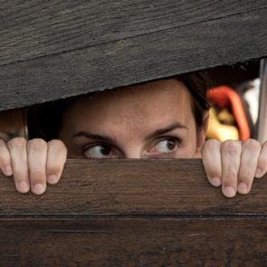Woman playing hide and seek