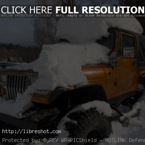 Off Road Jeep Car Covered With Snow