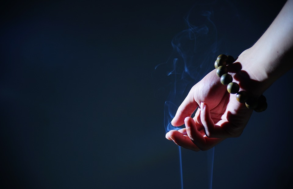 hand, buddhist prayer beads, smoke