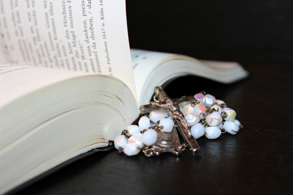 rosary, prayer book, hymnal