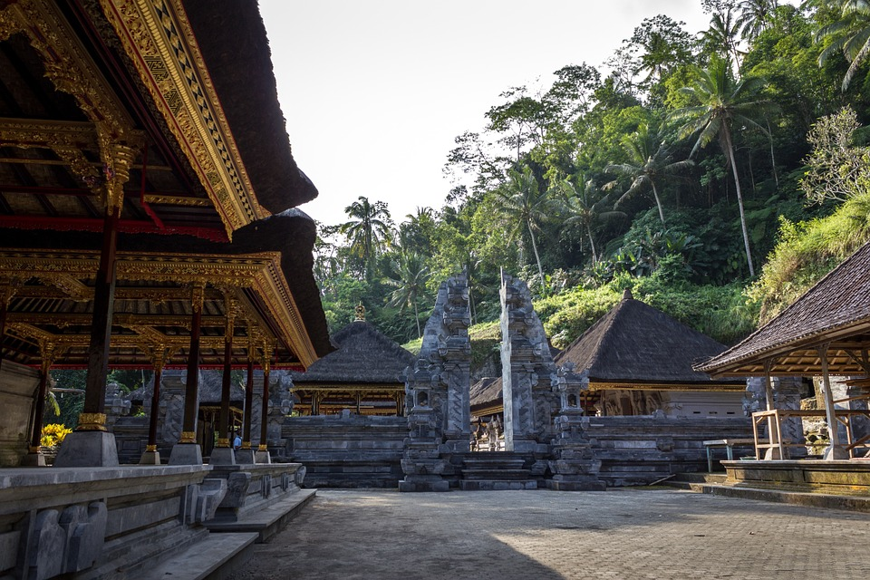 temple, huts, palm trees