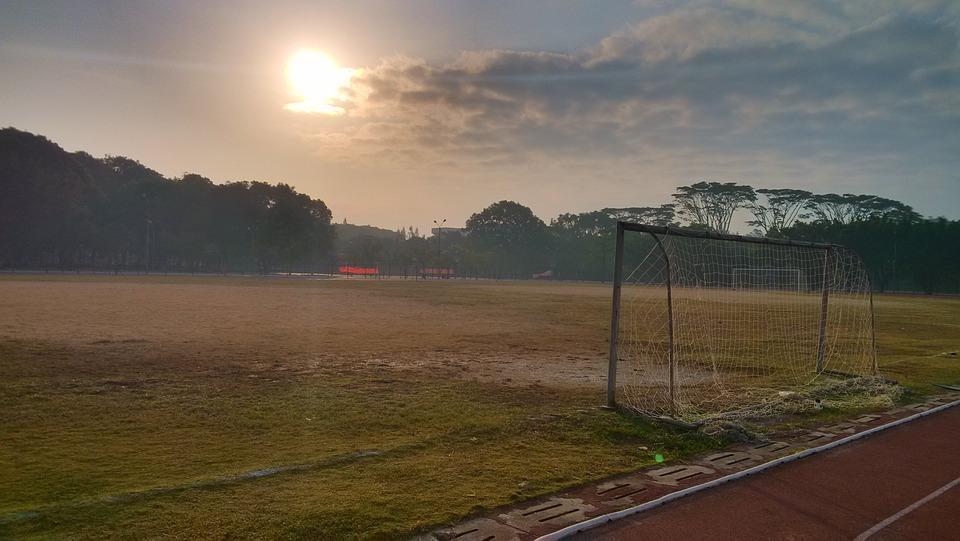 playground, athletic track, sunrise